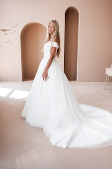 Beautiful blonde bride in a wedding dress