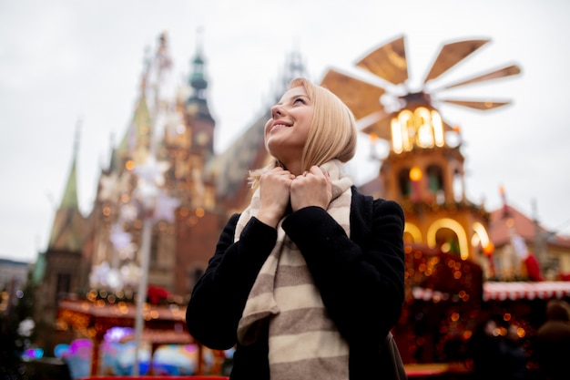 Beautiful blonde at the christmas market in wroclaw, poland