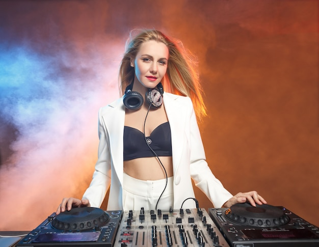 Beautiful blonde dj girl on decks - the party,