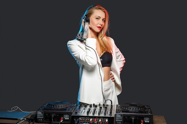Beautiful blonde dj girl on decks