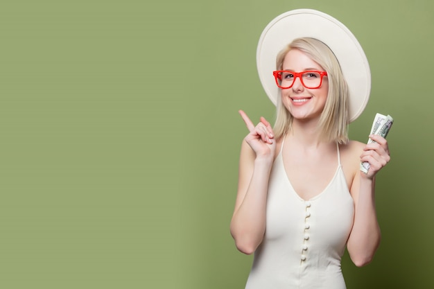 Beautiful blonde girl in glasses with money