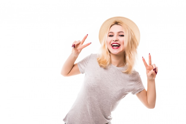 Beautiful blonde girl in hat show peace on both hands