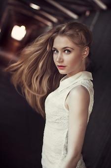 Beautiful blonde girl in a pedestrian tunnel