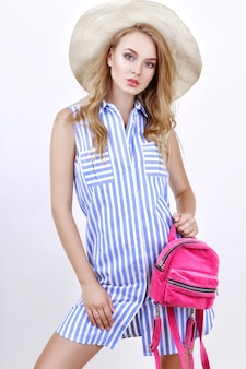 Beautiful blonde girl posing in summer clothes