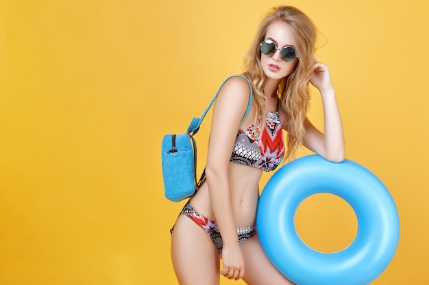 Beautiful blonde girl posing in summer look