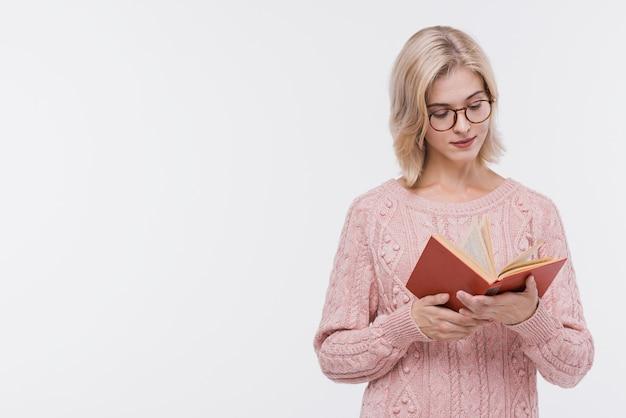 Beautiful blonde girl reading a book