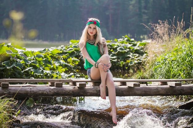Beautiful blonde girl in shorts and headband walk