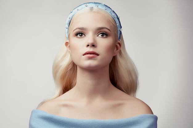 Beautiful blonde girl with diadem
