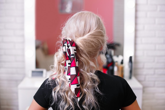 Beautiful blonde hair girl with fashion hair band clips