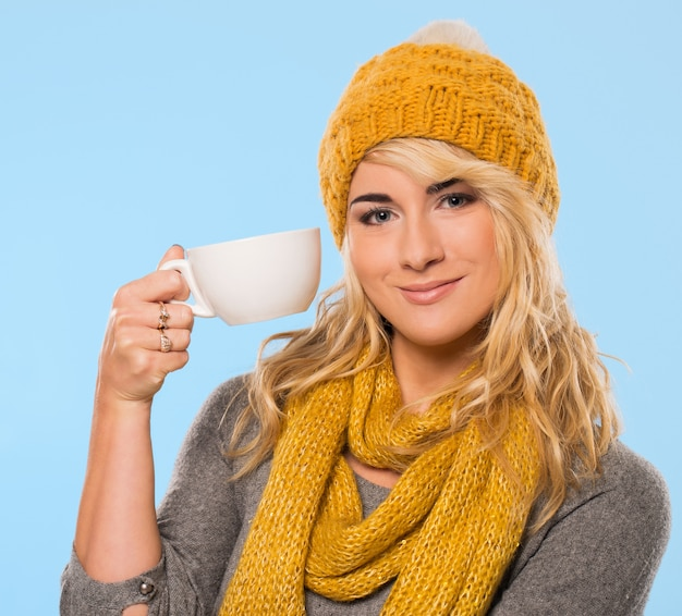 Beautiful blonde in hat and scarf