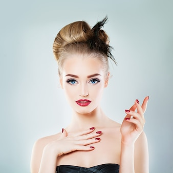 Beautiful blonde woman fashion model with empty hand