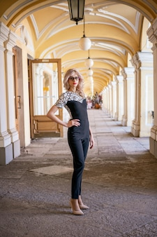 Beautiful blonde woman posing for the camera , walk around the city