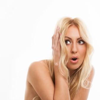 Beautiful blonde woman scared