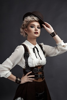 Beautiful blonde woman in steampunk style costume and earrings and necklace