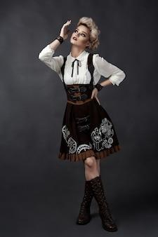 Beautiful blonde woman in steampunk style costume