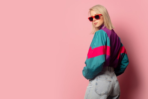 Beautiful blonde woman in sunglasses and 90s clothes