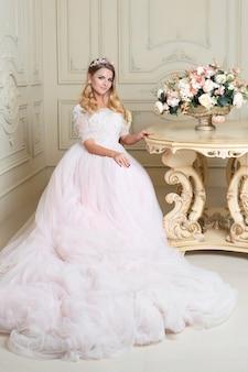 Beautiful blonde woman wearing gorgeous wedding dress