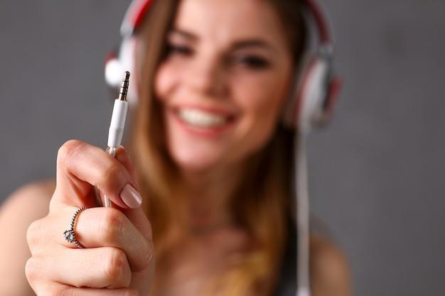 Beautiful blonde woman wearing headphones