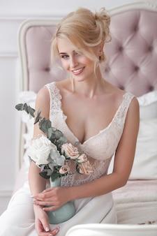 Beautiful blonde woman in a white dress