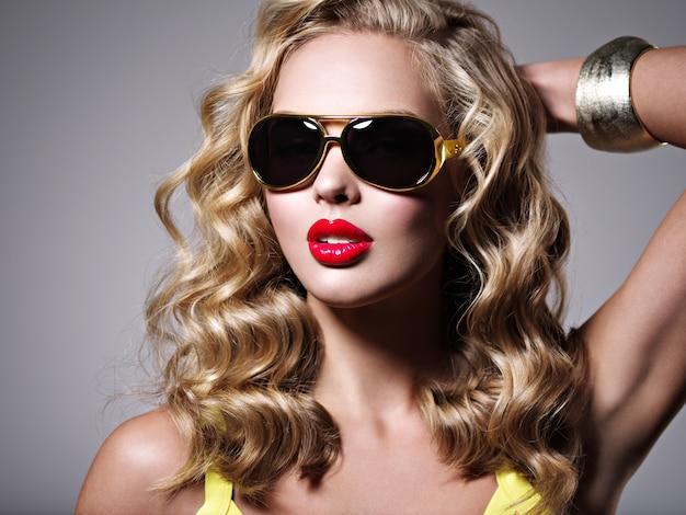 Beautiful blonde woman with long wavy hair.