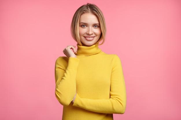 Beautiful blonde woman with yellow turtleneck