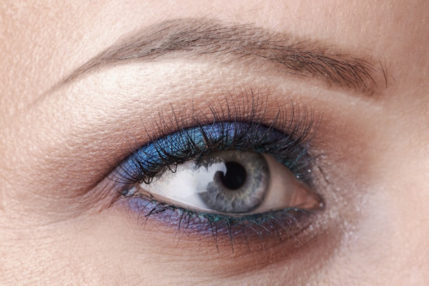 Beautiful blue eye close - up, bright make-up