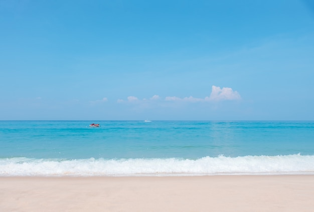 Beautiful blue ocean wave and jet ski on tropical beach.