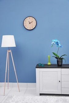 Beautiful blue orchid flower on the table in modern room
