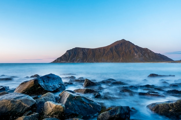 Beautiful blue sea with magnificent mountain in lofoten in sunset