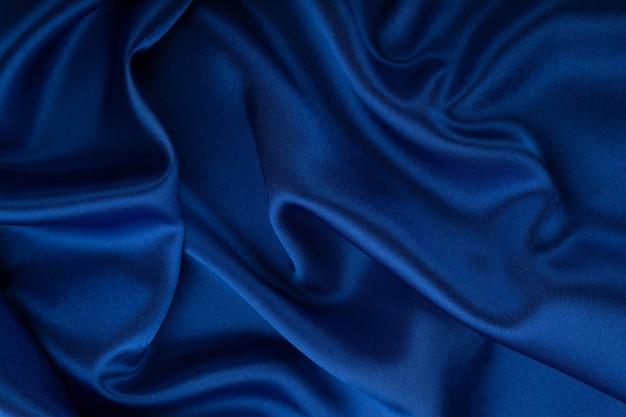美しい青い絹生地のテクスチャ背景