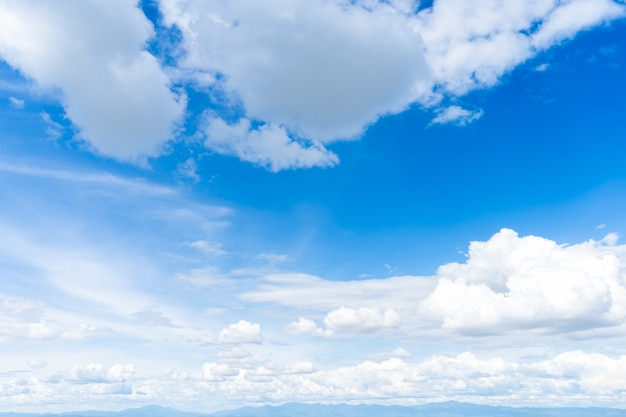 Beautiful blue sky background abstract clear texture with white clouds.