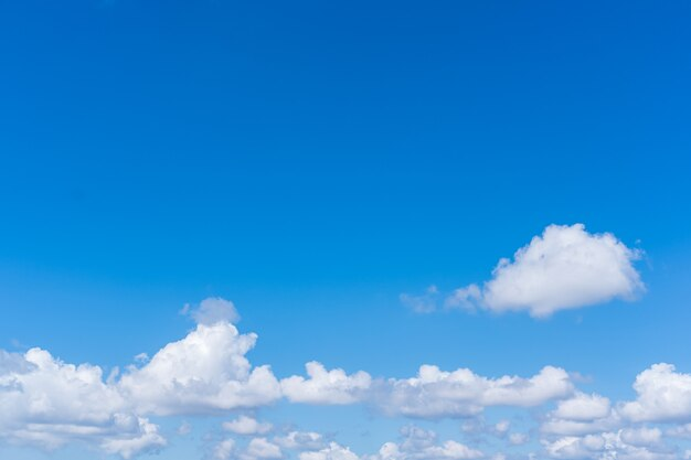 Beautiful blue sky with white clouds and copyspace