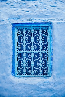 Beautiful blue windows of the ancient city medina