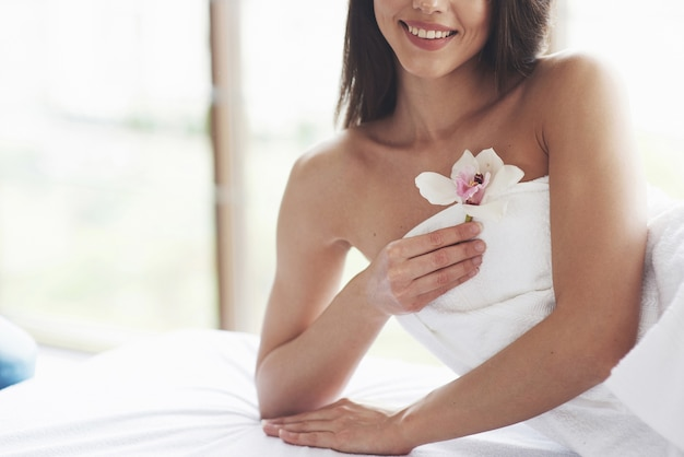 Beautiful body woman with white flower orchid and body care.