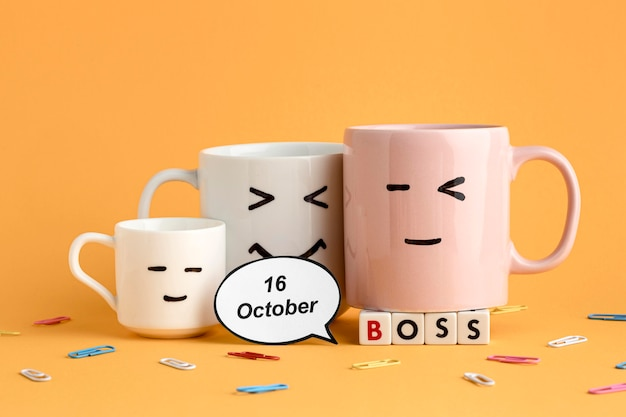 Beautiful boss day concept with cups