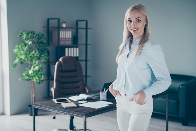 Beautiful bossy business lady hands pockets indoors