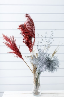 Beautiful bouquet of beautiful from dyed grass. the work of the florist. flower delivery.