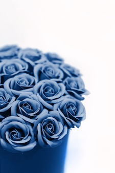 Beautiful bouquet of blue roses isolated. toned in classic blue.