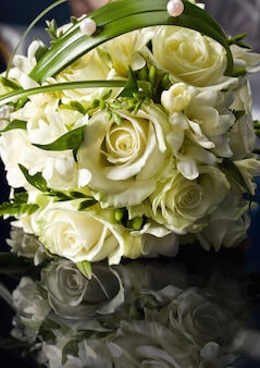 Beautiful bouquet of the bride executed from roses