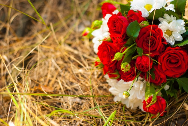 Beautiful bouquet of bright red roses and white daisies