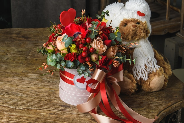 Beautiful bouquet of flowers with teddy bear
