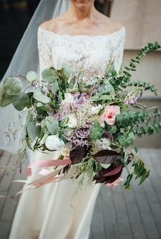 Beautiful bouquet in hands of the bride