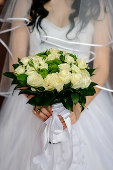 Beautiful bouquet in the hands of the bride