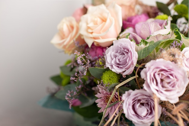 Beautiful bouquet of mixed flowers. greeting card. horizontal image, selective focus, blurred background