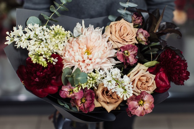 Beautiful bouquet of mixed flowers with peonies.