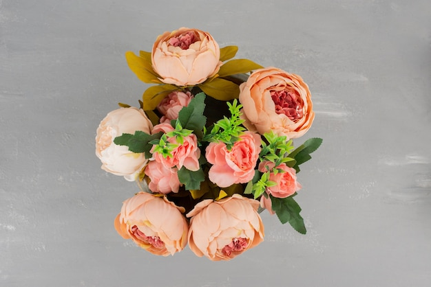 Beautiful bouquet of pink roses on grey surface
