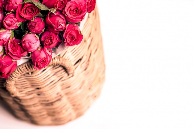 Beautiful bouquet of red roses in basket