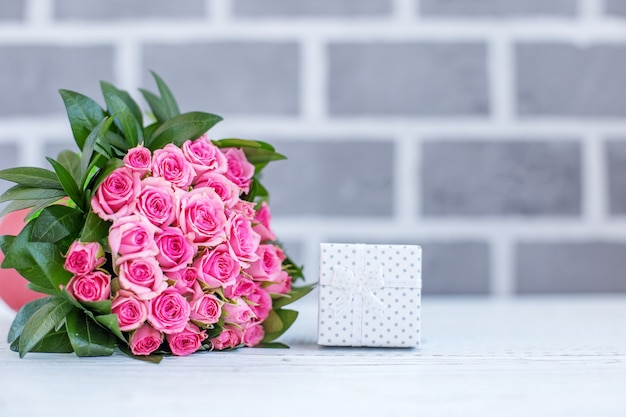 Beautiful bouquet of roses for greetings. gift box. concept happ