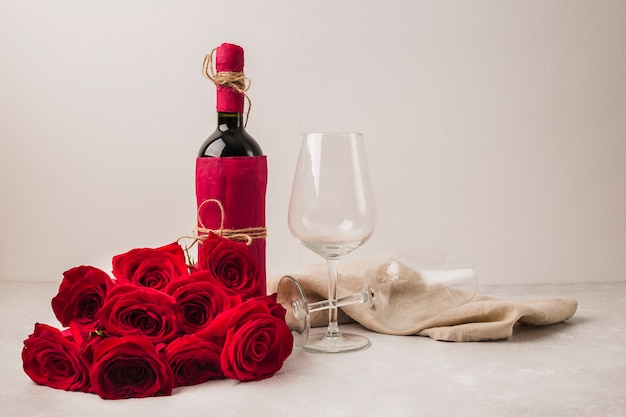Beautiful bouquet of roses and wine