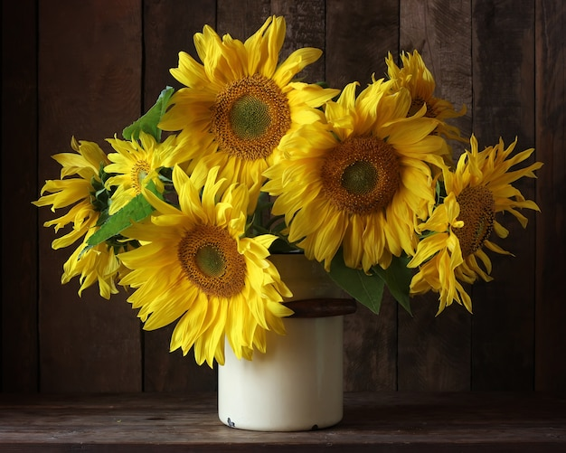 Beautiful bouquet of sunflowers in a can